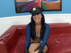 Breasty cop in boots and low cut top sucks pecker
