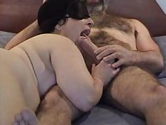 Masked chubby mature wife gives good sucking and licking  to her curly hubby\'s large dick - short but enjoyable