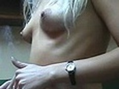 Lecherous blond sweetheart with petite sticking mambos walks naked in her room filmed by her boy-friend with dilettante cam in his hands. This guy doesn't like her smoking but really enjoys her hot nude body shyly overspread by New Year tree decoration :)
