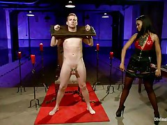 Queen Skin Diamond fastened Sebastian Keys with fetters. The ebony female-dom whips his small cock until its raw and red. She makes him implore for more and squeal like a perverted little piggy as she clamps his teats and puts clothespins all over his body.