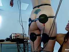 A sexy redhead with valuable boobs and a bald love tunnel is bound in front of this naughty brunette. Her body is covered with electrodes and she's getting some stimulation through them and likewise from that sextoy the dark brown is using to rub her clitoris. Look at her moaning and receiving all the socking pleasures she wants.