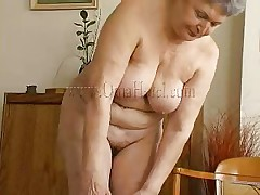 Granny takes off her shirt and bra and her heart rate increases as this babe begins massaging those big saggy boobs. Just like in her youth this fucking doxy takes off her clothes to pleasure men! Granny removes those white panties and reveals her saggy hairy cunt that she's enjoys rubbing. What she's up to next?
