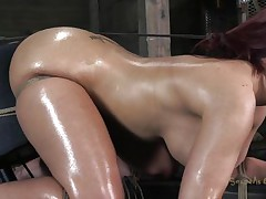 Oiled and tied up our redhead acquires a unfathomable mouth fucking from her executor. This chab is not joking around and gives this whore one hell of a fuck. She sits there tied and with a big rodeo fucking machine under her ass. This voluptuous whore needs to acquire all her holes drilled and filled with cum!