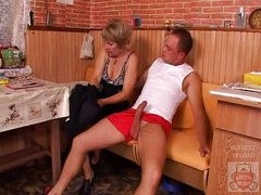 Mature mother and the Son&amp,#039,s friend have a worthy time on kitchen.