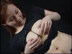 Oriental chick with lactating tits squeezes and squirts
